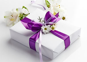 gift box and flowers on a white backgrou
