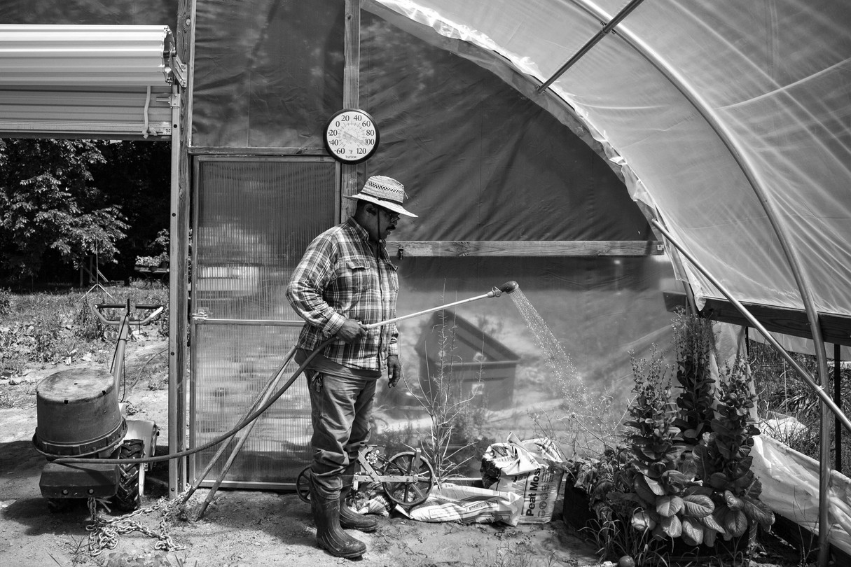 Watering Chores in one of the Browntown Farms Hoop Houses