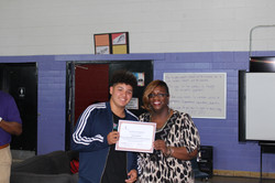 All Smiles.  Ms. Ricketts & student.