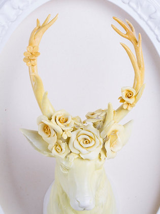 Bust of deer with flowers