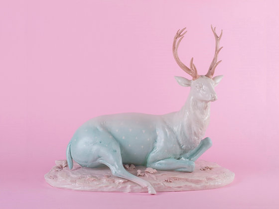 Deer with porcelain base
