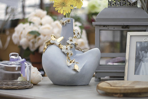 Vase with flowers and butterflies
