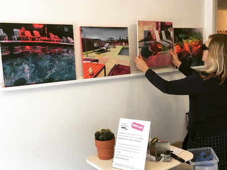 Lucinda Metcalfe puts the finishing touches to her exhibition 'Enjoy'