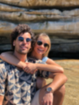 Couple wearing sunglasses and rocks