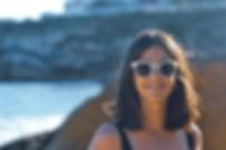 Woman wearing white sunglasses