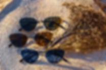 Three cat eye sunglasses
