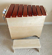 Bass marimba shown with small riser platform.