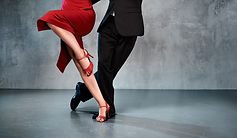 Feet of professional tango dancers in da