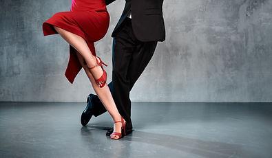 Feet of professional tango dancers in da