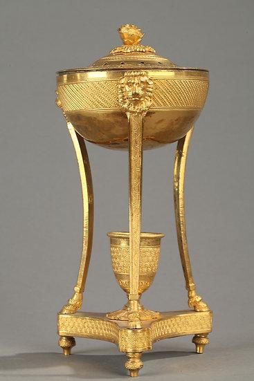 Perfume Brule en bronce dorado con mercurio.