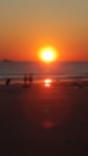 Sunset over a beach togo with theme for album.  Contains info on live gigs and upcoming shows.
