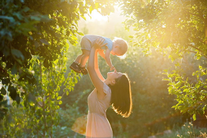 Happy young mother playing and having fu