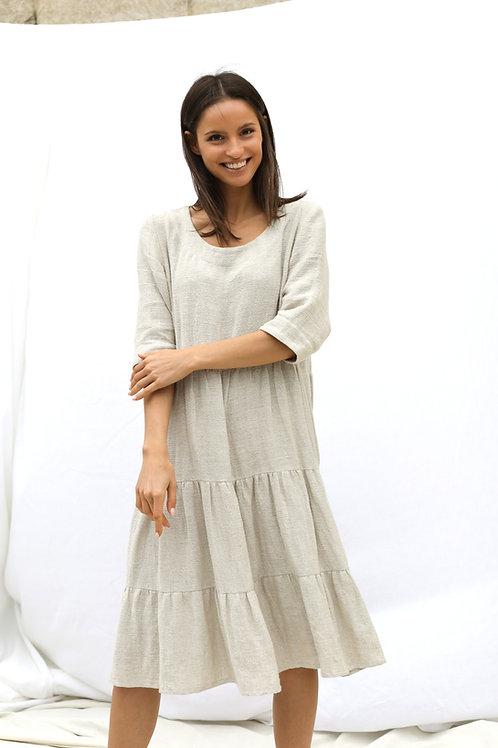 Szeroka lniana suknia z falbanami