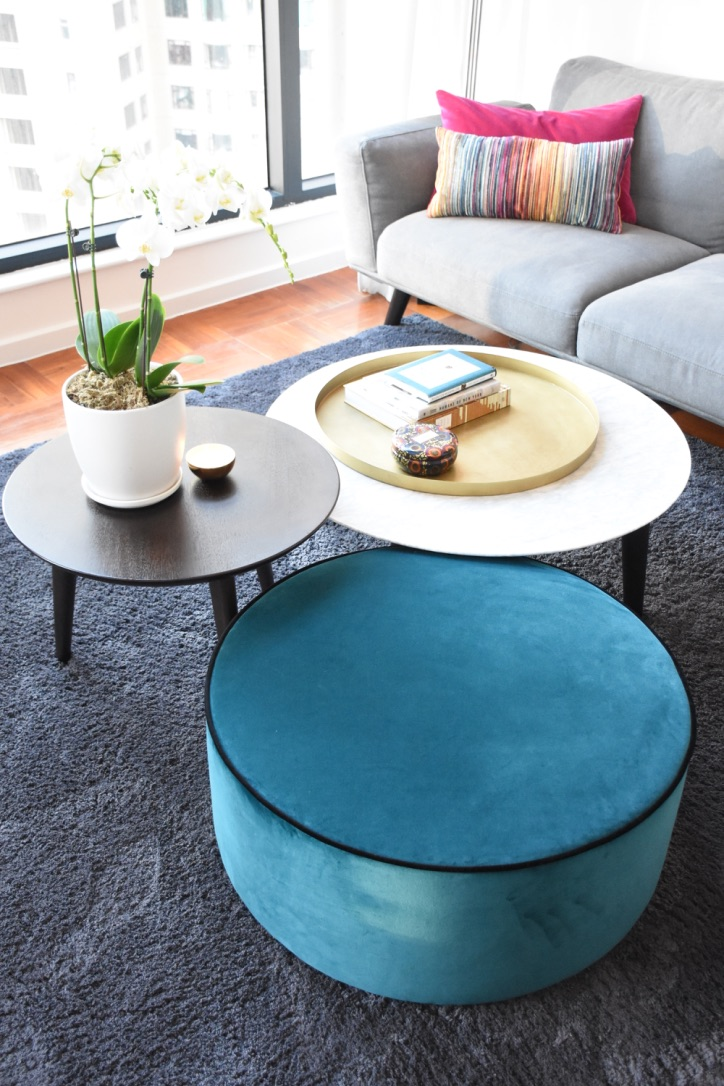 Teal ottoman forefront