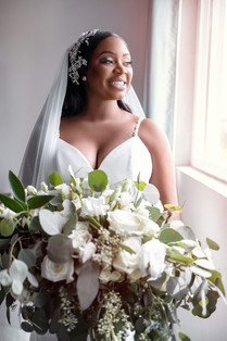 bride holding white rose bouqet portrait