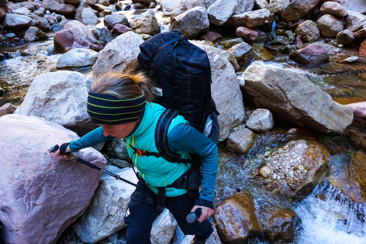 Elyssa Shalla rock hopping down Kanab Creek