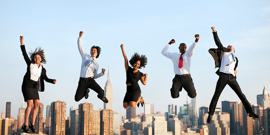 Happy business people - jumping for joy
