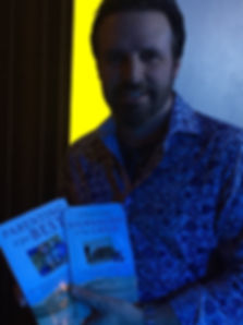 Mark Wills holding books by Roni Wing Lambrecht