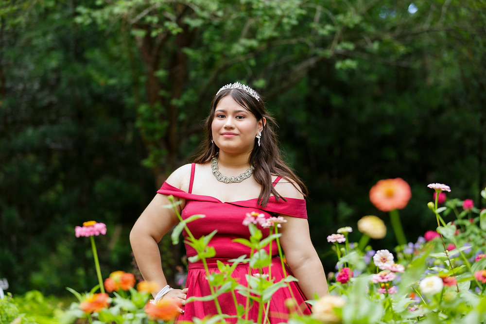 Prom portrait of Diana B. surrounded by flowers in the Mercer Botanic Garden.