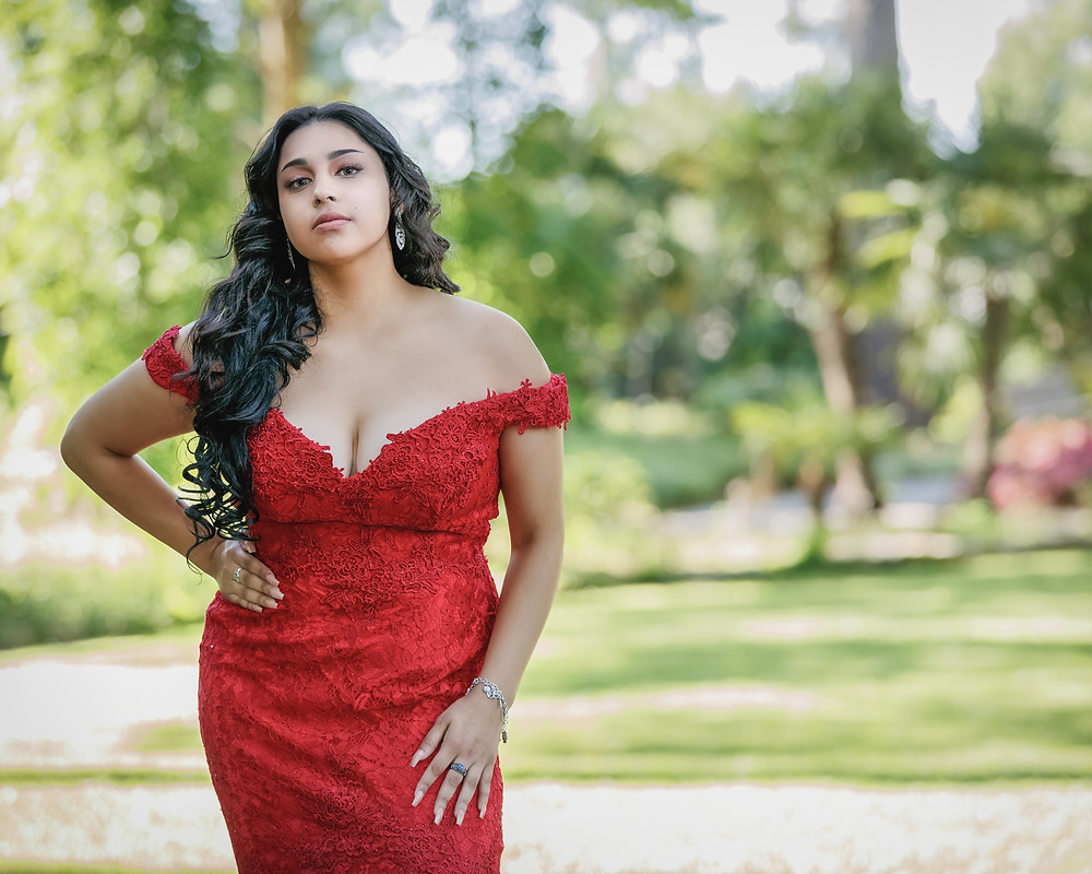 Jennifer is posing in a luscious red prom gown in Mercer Botanic Gardens
