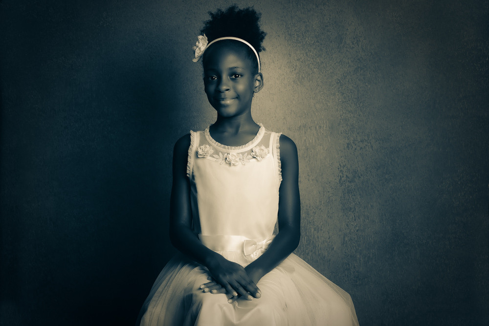 Split tone image of B. Moore child portrait.