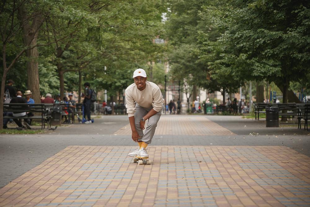 Rejy Drayton is doing one of the things he loves: skateboarding in Marcus Garvey Park in Harlem.