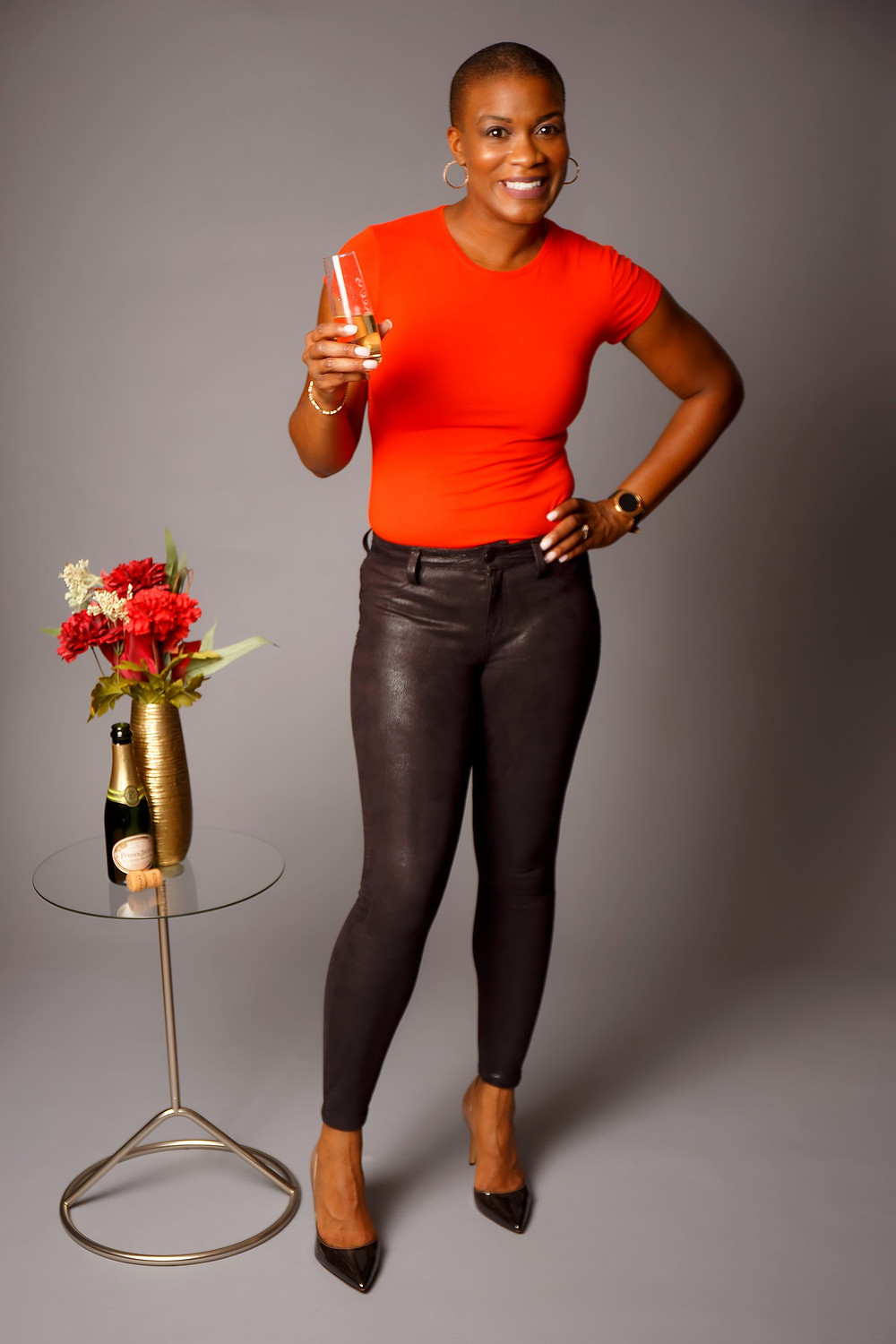 Gwendolyn Houston-Jack celebrating with a glass of champagne