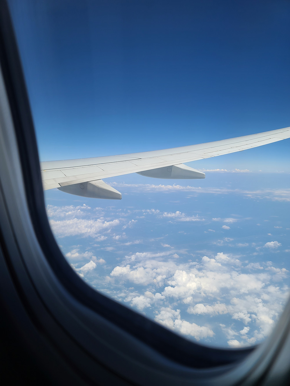 View of the clouds outside my window on the American Airlines flight.