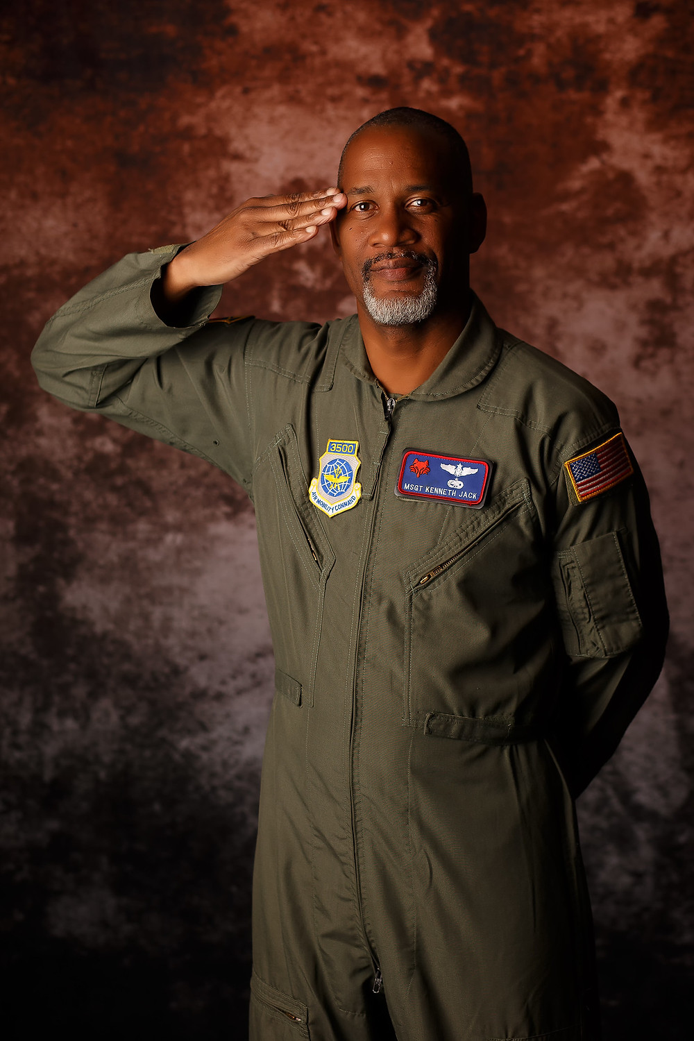 Master Sergeant K Jack of the United States Air Forcesaluting in his flight suit