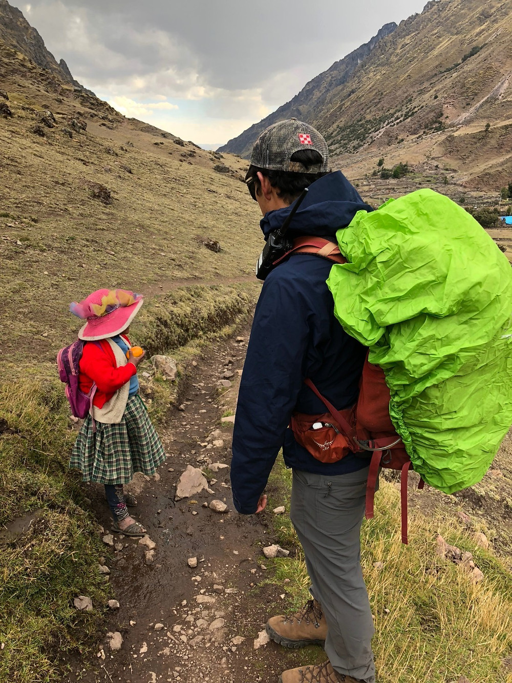An Explora guide stopping to chat with a Quechua girl on one of our exploration hikes - Photo: Jen Stover, Paradox Travel   Read more about our experience with Explora at www.paradoxtravels.com