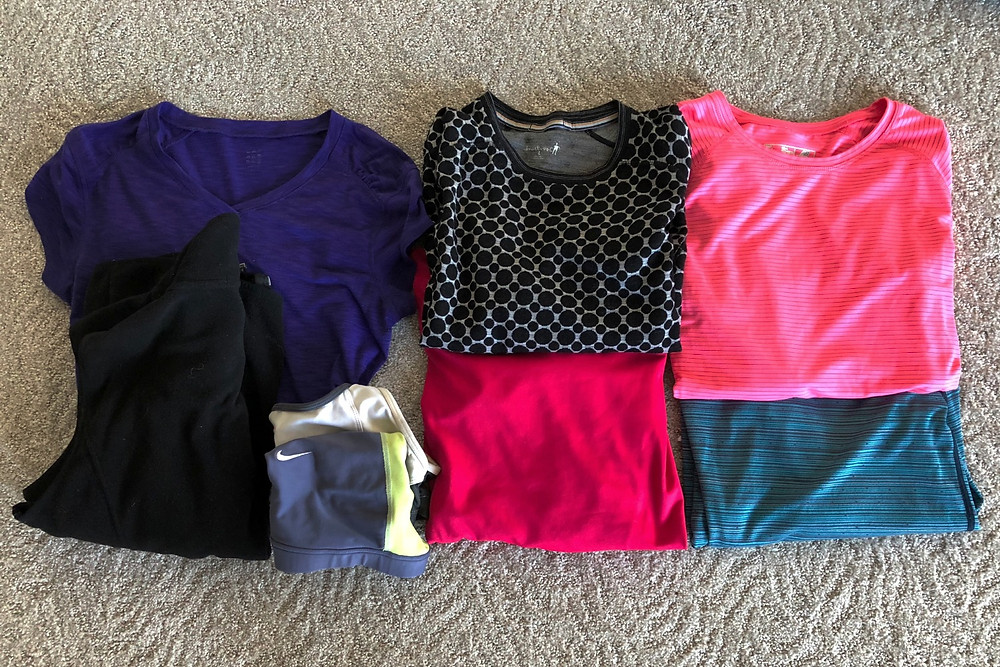 Iceland gear packing list - upper body base layer. Selecting colorful or patterned items helps make them cross-functional: you can wear them during your activity day, and then wear them to dinner.
