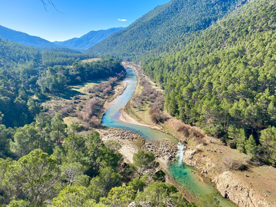 viewpoint along the east side of Quadlaquiver River, Sierra de Cazorlas, Spain - See our complete Southern Spain road trip itinerary at Paradox Travel