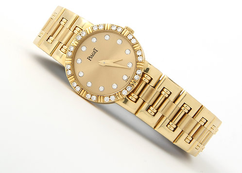 Piaget ladies 18K gold Dancer with champagne diamond dial and diamond beze