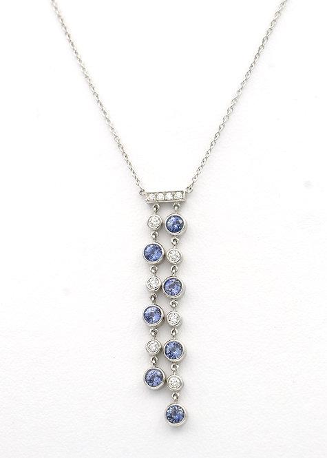 Tiffany & Co. Double drop Jazz Pendant featuring round brilliant cut diamonds an