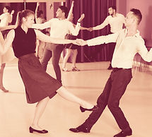 Young%20positive%20people%20dancing%20lindy%20hop%20in%20pairs%20in%20dance%20hall_edited.jpg