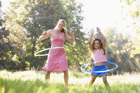Woman and young girl with hula hoops out
