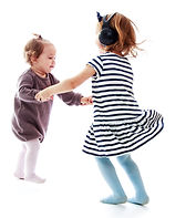 Two girls holding hands sisters dance in