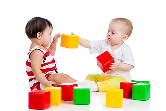 two babies or kids playing together with