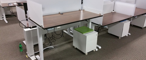 Programmable sit to stand with acrylic divider screens.