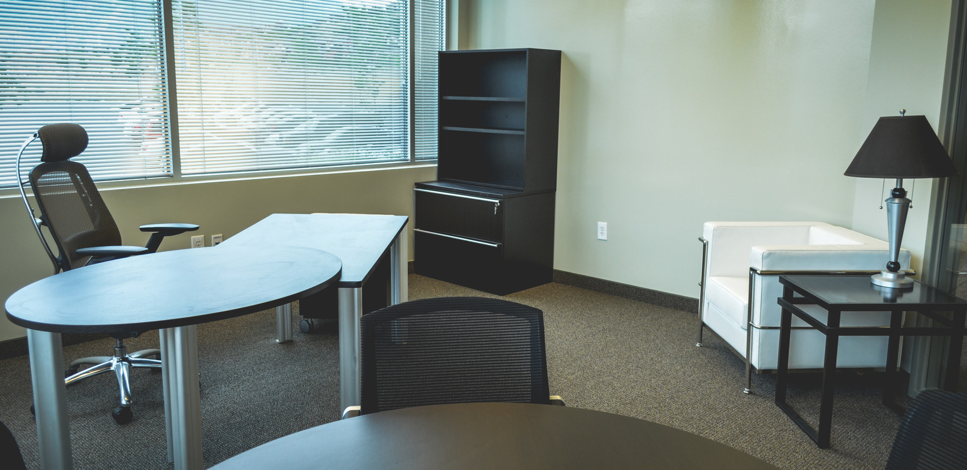 Mobile private office, round table, lateral filing unit, bookcase, side chair, coffee table