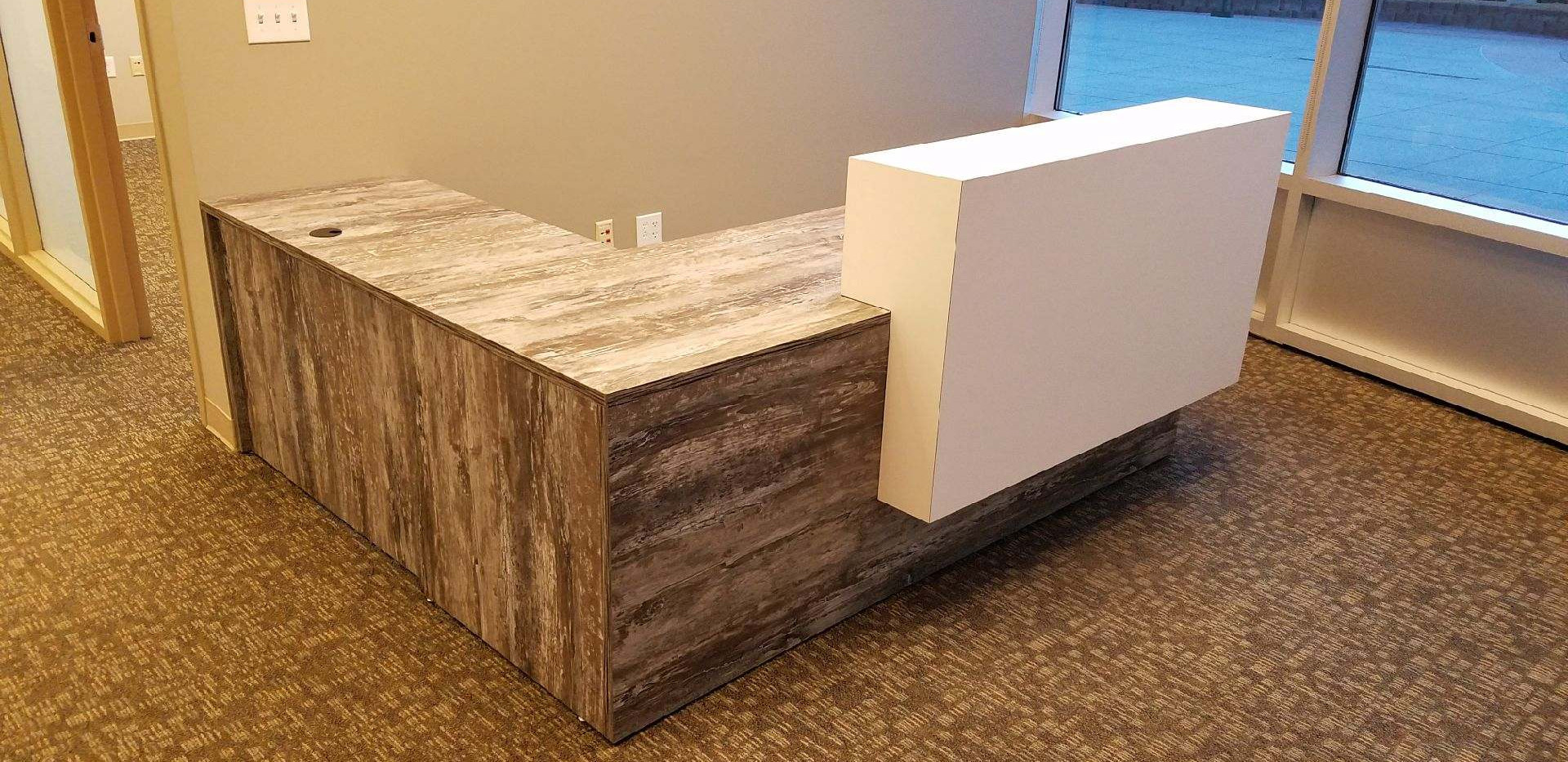 Custom Overture reception desk in Intrigue laminate