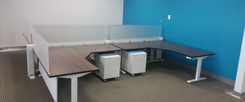 Programmable sit to stand L shape configuration with acrylic and frosted glass divider screens and an underneith privacy screen