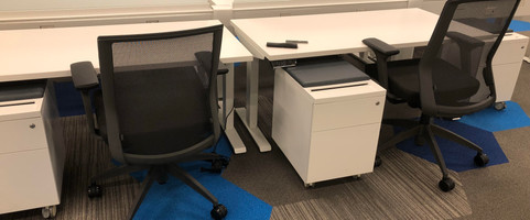 """60"""" Friant sit to stand benching system with frosted glass divder screens, mobile pedestal and white work surface"""