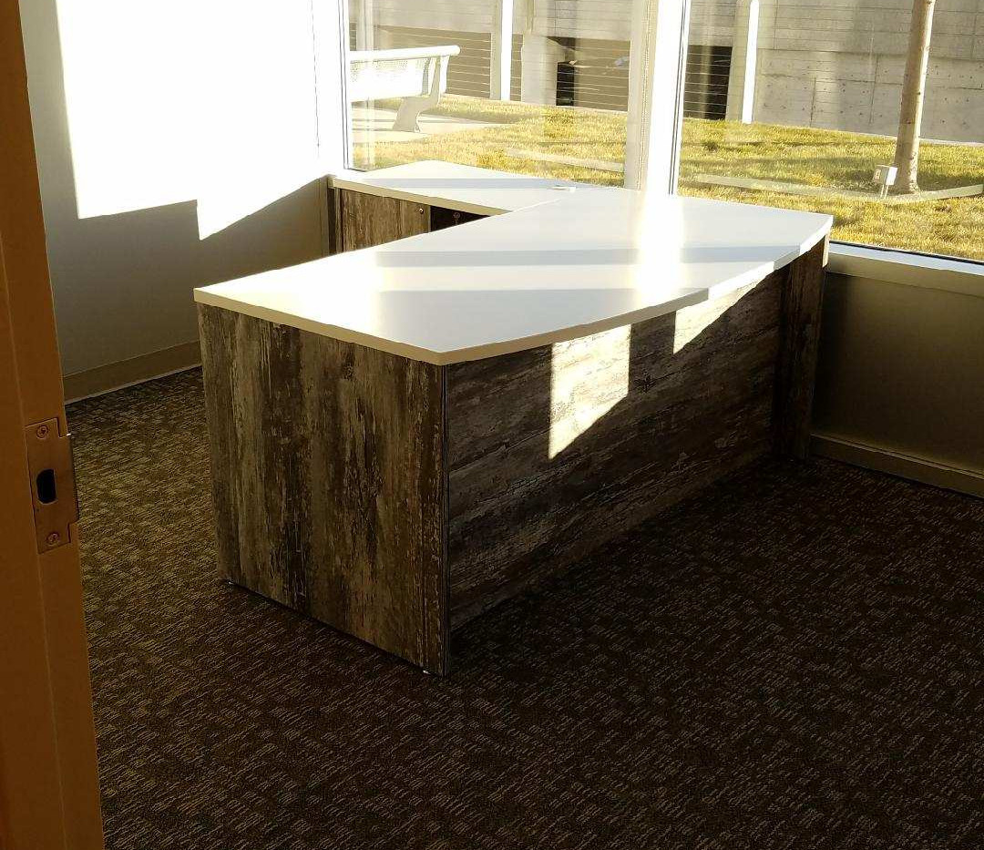 6X6 Convergence private office desk with white work surface and two supporting BBF pedestals