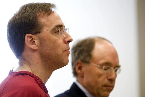 Man (Deene Juncker) in jail jumpsuit at sentencing with his attorney