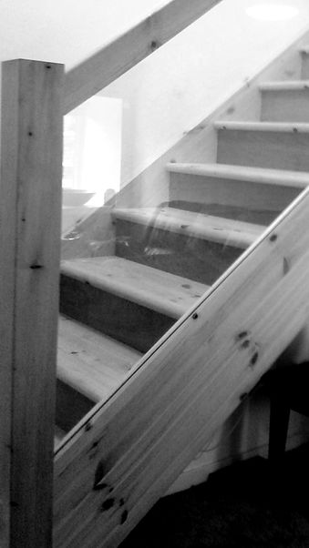 pine staircase with glass