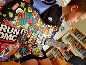 Stickered up guitar gets pupils frothing, guitar lessons in Wellington and Lower Hutt.