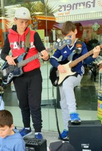 Boys jamming with their bass and guitar on the streets of Wellington
