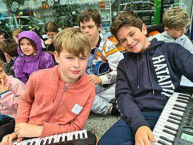 Two boys playing piano during a holiday