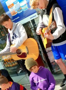 Young Wellington guitarists busking during school holiday program April 2019